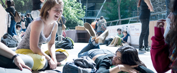 IMG: Students relaxing near library while we work.